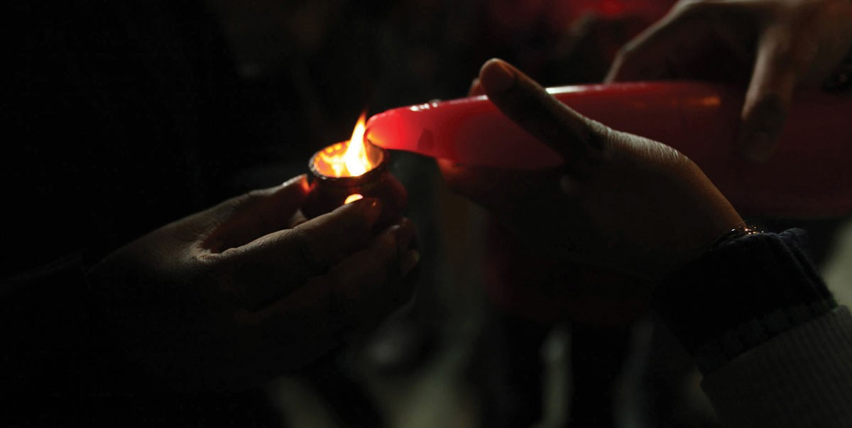 Lighting of a candle for the celebration of Diwali, a five-day festival of lights