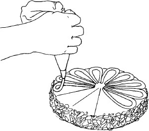 Figure 11-13 Piping the macaroon decorating paste on the top of the Diplomat Cake