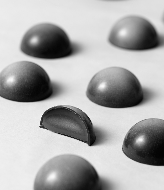 The finished molded chocolates should release easily from the mold. They will have a shiny surface and an even shell throughout.